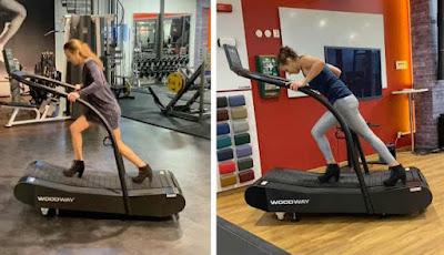 Wanita latihan di treadmill pakai sepatu hak tinggi