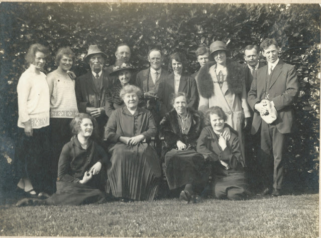 Group of people in front of a hedge