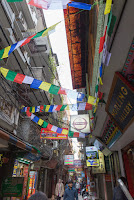 prayer flags and shops at majnu ka tilla new aruna colony delhi india