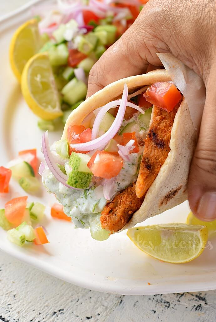 closeup of grilled chicken gyro with homemade tzatziki sauce
