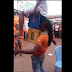 WOW!! YOU CAN'T JUST BELIEVE TILL YOU WATCH THIS!! Is This Magic Or Real? See Man Carried Another Man & 2 Crate With His Teeth In Nsukka, Enugu State (Photos/Video)