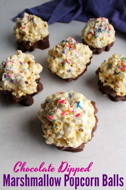 Marshmallow popcorn balls are a fun and easy treat that just take a few minutes and a few ingredients. Dip them in chocolate and top them with sprinkles for an extra festive and delicious treat!