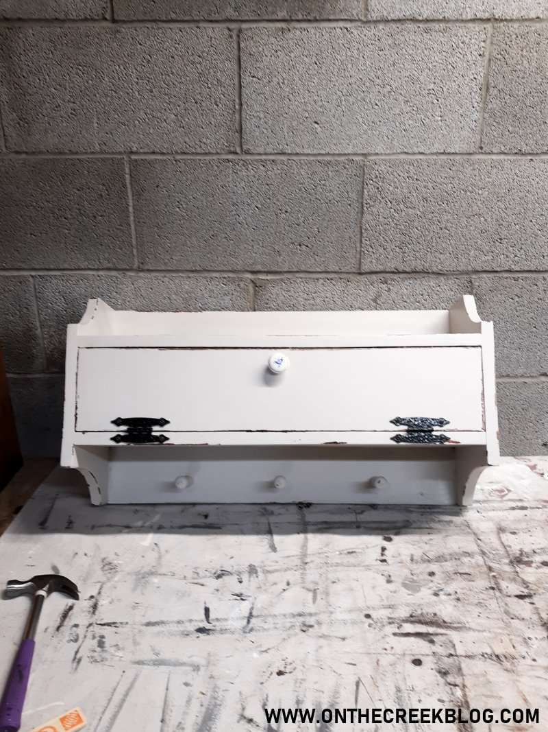 White chipppy/distressed cabinet perfect for coffee supply storage! | On The Creek Blog