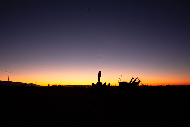 View of sunrise in Borrego Springs with metallic scorpion/locust sculptures in foreground (Source: Palmia Observatory)