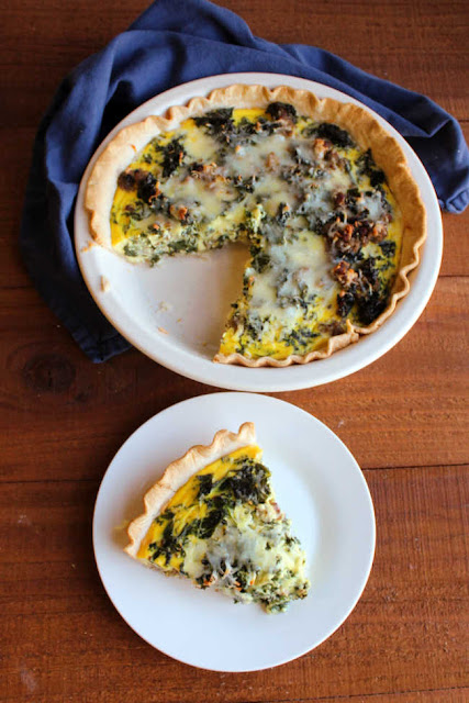 slice of quiche on plate with remaining pie nearby