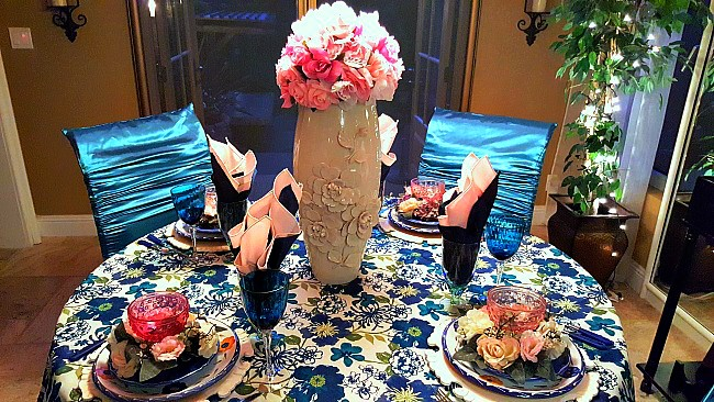 Boho chic tablescape with blues, greens and pink. Created at LifeandLinda.com