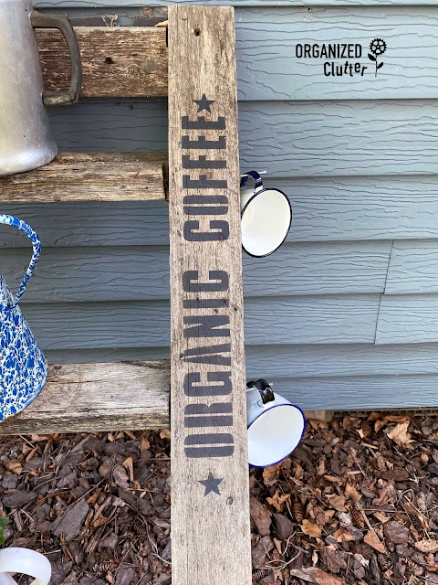 Photo of a ladder stenciled with organic coffee