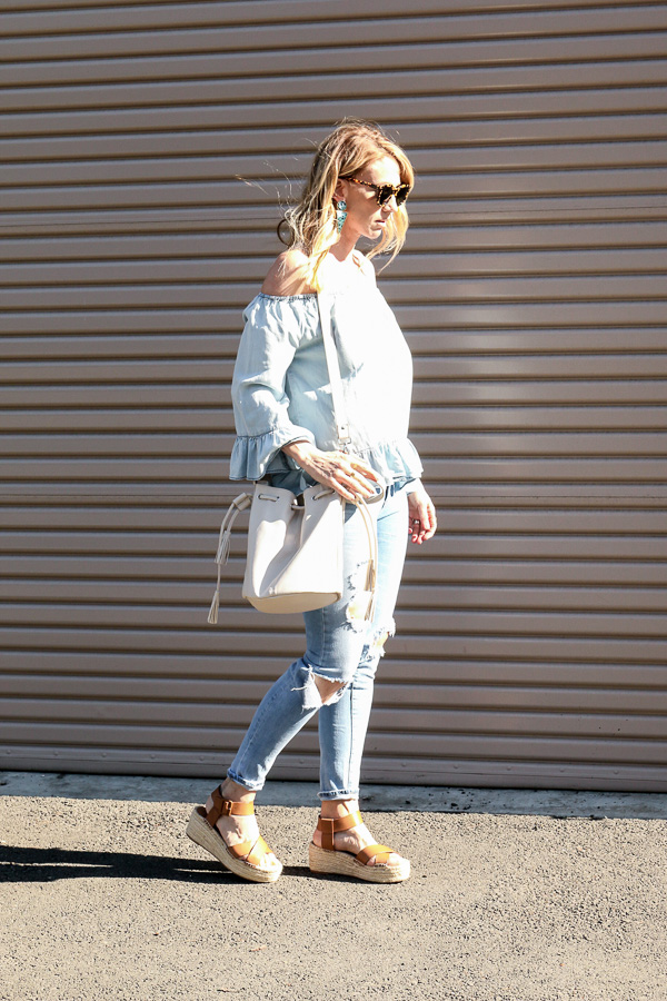 bucket bag ripped jeans