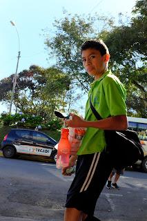 boy on sidewalk in Santiago de Puriscal
