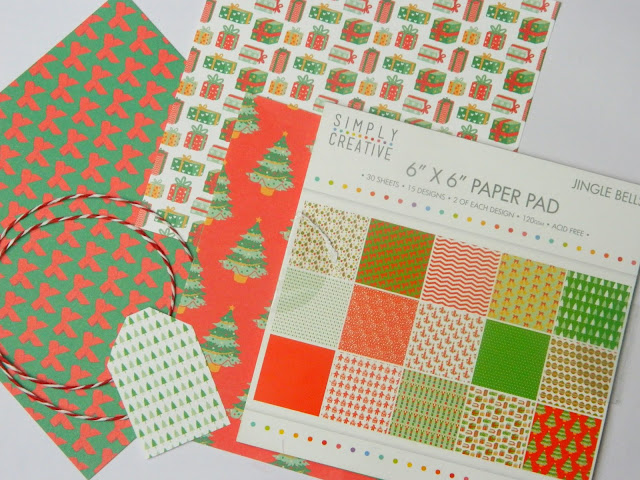A Christmas Paper pad and supplies to make your own Christmas gift tags