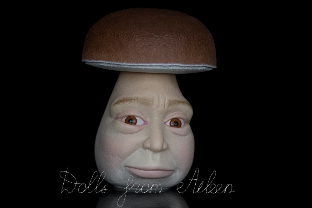 OOAK clay enchanted mushroom sculpture looking at camera