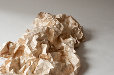 Diseño de cobija con tela y madera