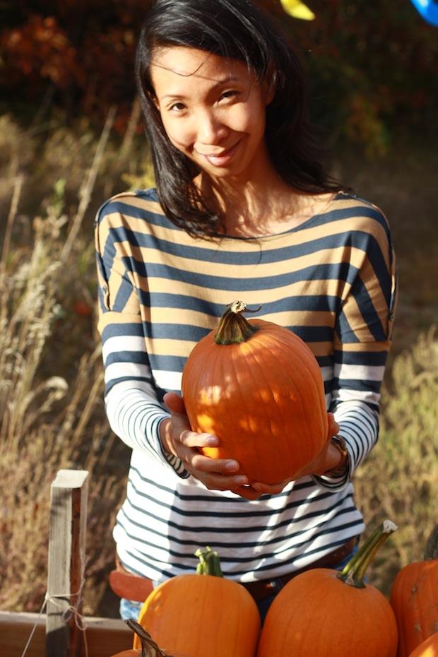 Reese holding pumpkin