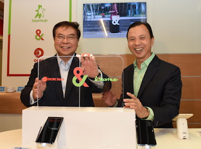 Source: OCBC Bank. OCBC Bank's Group CEO, Samuel Tsien (left), and StarHub's CEO, Tan Tong Hai (right), forge Singapore's first bank-telco strategic partnership with the first store-in-store at OCBC Bank's orchardgateway branch.