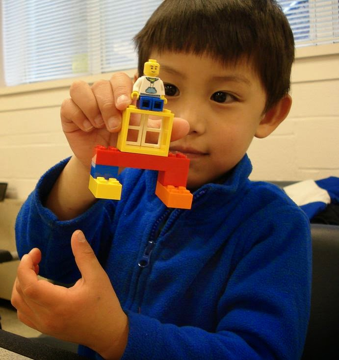 Kid LEGO building at Davis