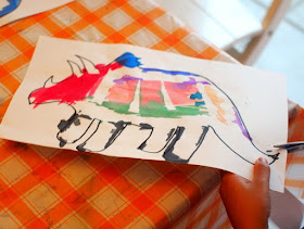 cut out your tape resist dinosaur art project