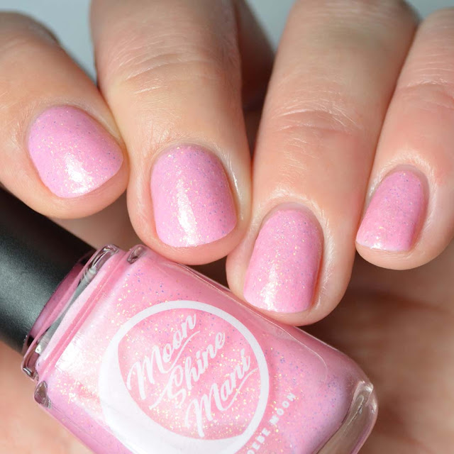 pink nail polish with iridescent glitter