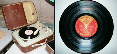 A portable record player and an LP (long play) record   with the new technology of microgrooves.