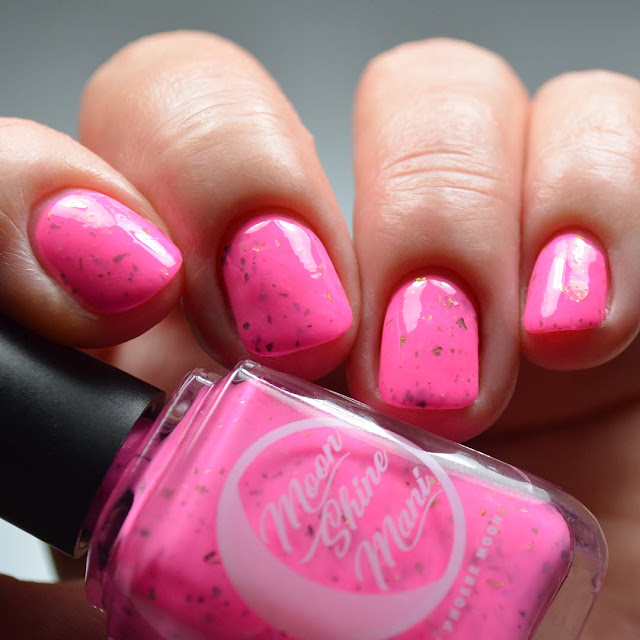 neon pink nail polish swatch with color shifting flakies swatch different angle