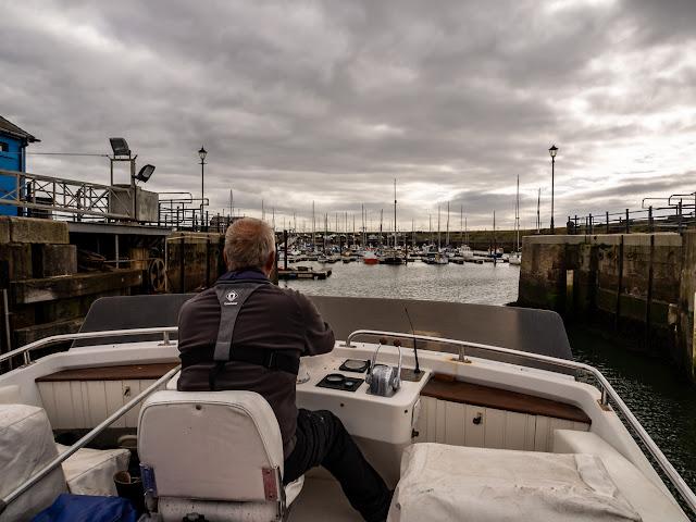 Photo of Phil bringing Ravensdale into Maryport Marina