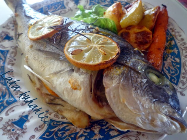 Oven baked gilt-head bream by Laka kuharica: amazingly tasty fish easily copes with strong herbs and flavours.