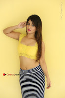Cute Telugu Actress Shunaya Solanki High Definition Spicy Pos in Yellow Top and Skirt  0481.JPG