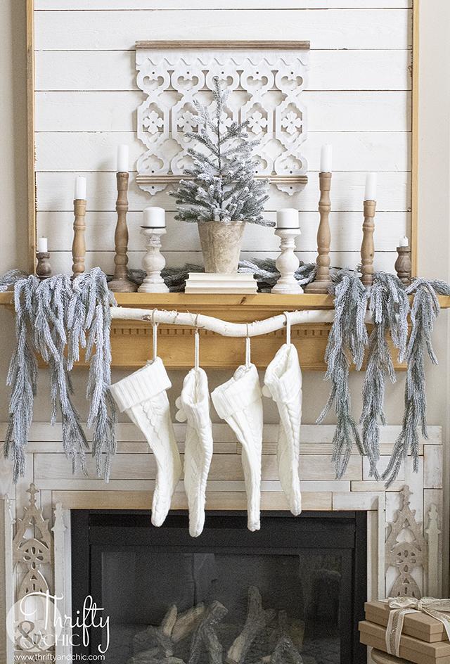 Cozy living room christmas decor. Woods and white Christmas decor. farmhouse christmas decor and decorating ideas. Neutral Christmas mantel decor