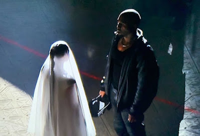 kim kardashian wearing wedding dress with kanye west again