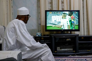 Photos of Buhari as he watches Nigeria-Cameroon match