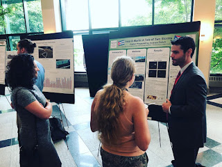 Andrew Polich presenting his poster to a fellow participant (center) and Chelsea Loftus (left) at the 2019 Appalachian State Energy Summit.