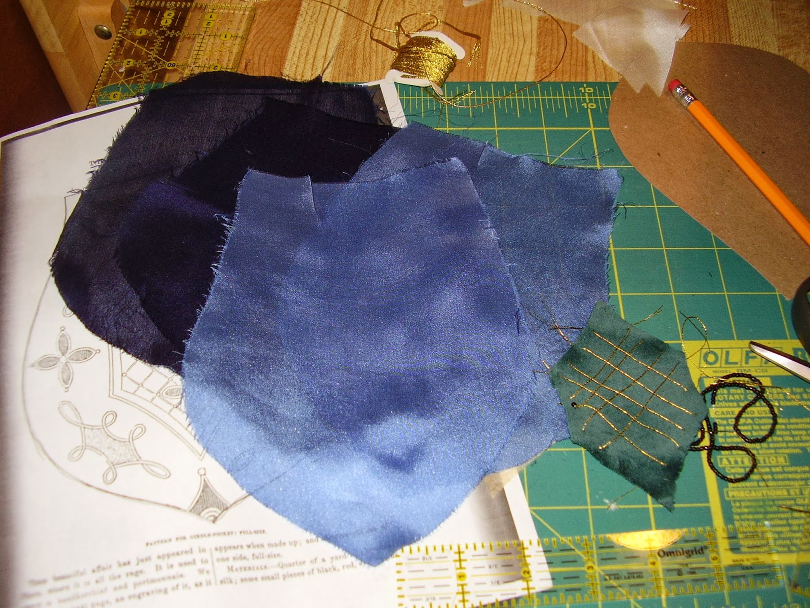 Dyed blue silk pieces and applique center for girdle pocket.