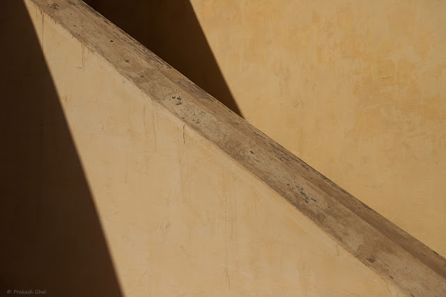 A Minimalist Photograph of a Diagonal Line created by the Siderail of a Staircase.