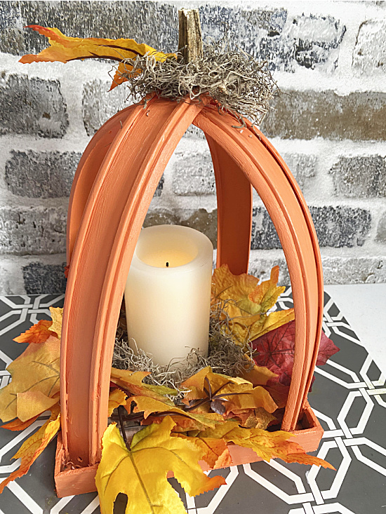 lantern with leaves and a candle