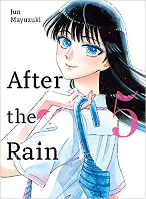 Teenage girl with an umbrella over her shoulder smiling
