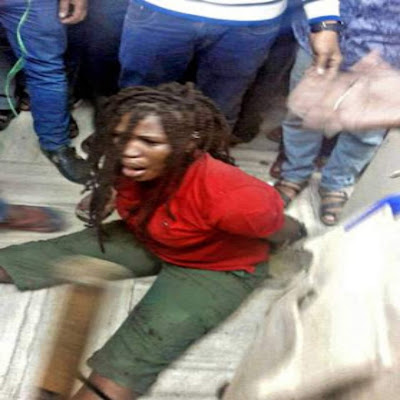 So Sad A Nigerian woman was tied with a rope by the police here in a bid to restrain her after she allegedly attacked shopkeepers and policemen in an inebriated condition at National Market
