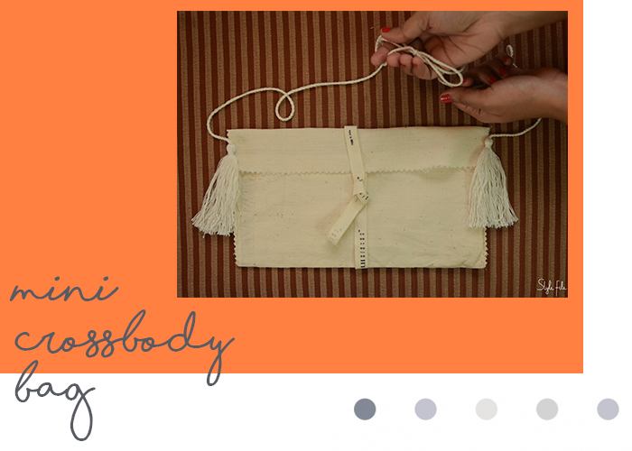 An image of a cream mini crossbody sling bag with tassel made with a do-it-yourself project on Style File