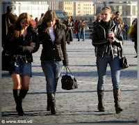 Girls in jeans and boots on the street