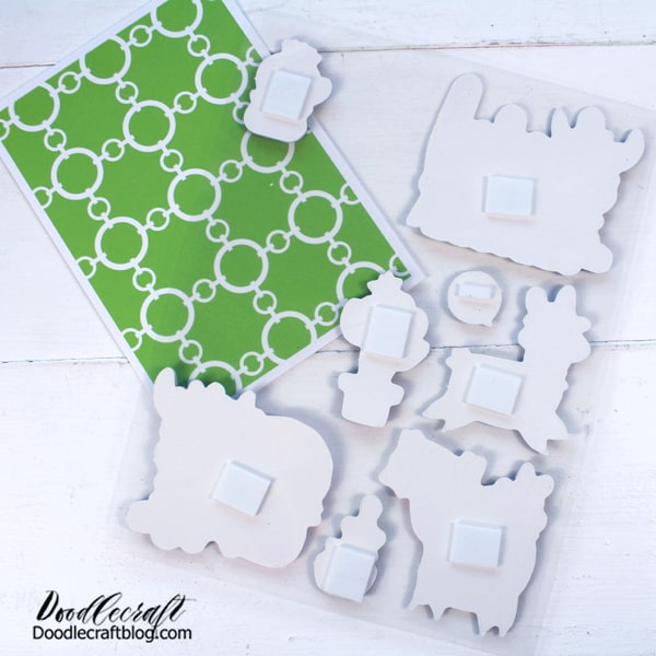 Step 1: Dollar Tree Cards Open the packages of cards and stickers. The back of the pop-up stickers is a foam square. This gives the card fun dimension.