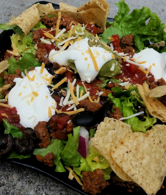 Taco Salad Topped with Cheese & Sour Cream