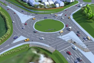 A roundabout without much traffic on it