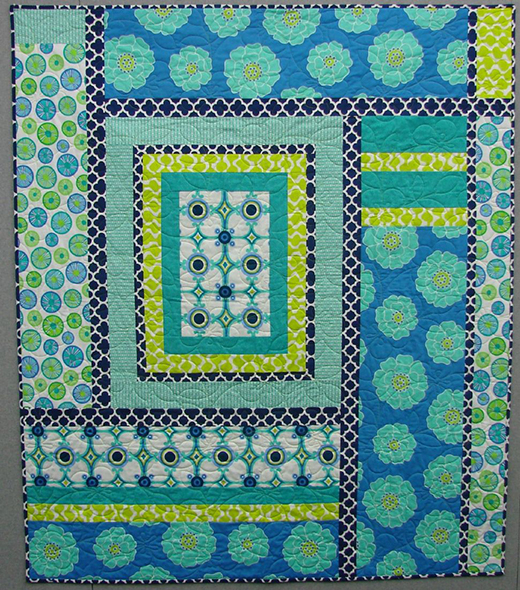 A Blue Moment Quilt designed by Jean Anne Wright of Benartex