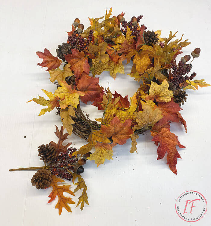 Easy no brainer DIY Fall wreath made with recycled garlands and seasonal picks from old wreaths you've grown tired of. A budget fall decorating idea.