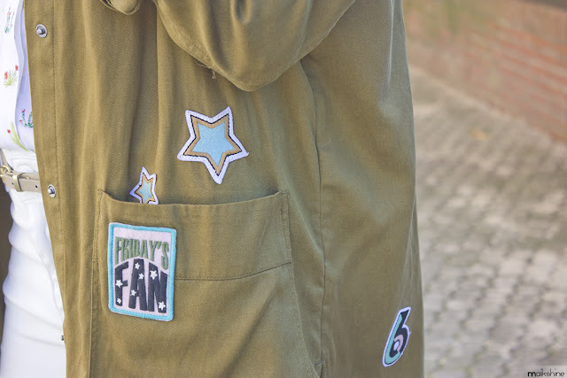 Patched parka outfit detail