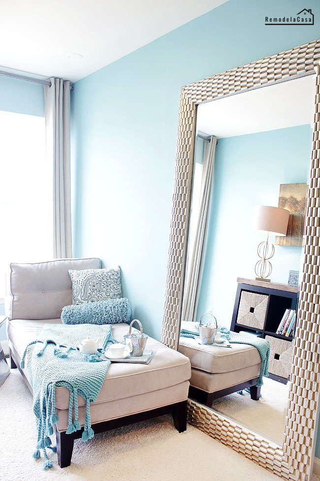 A big mirror creates the illusion of more space in small rooms