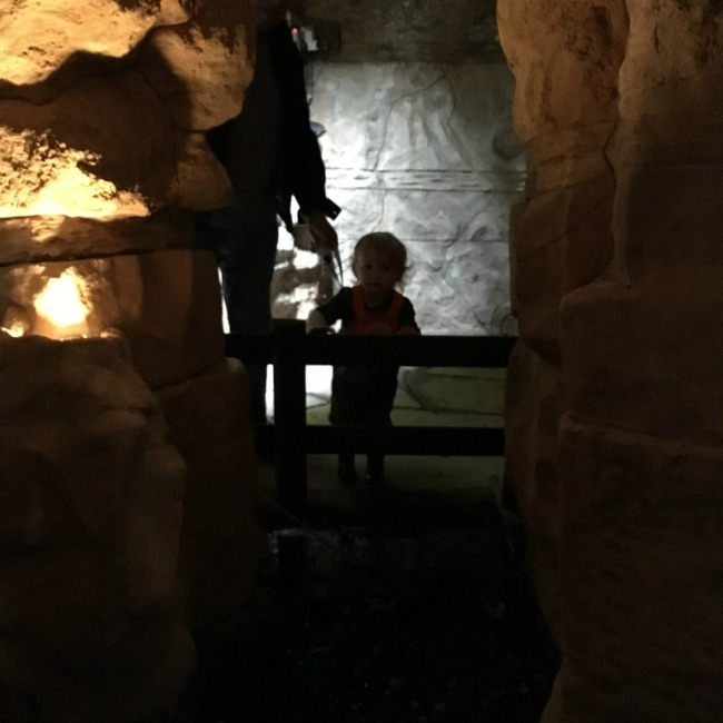 toddler silhouetted through a gateway