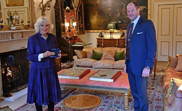 The Duchess of Cornwall took over the role of Colonel-in-Chief of The Rifles from her father-in-law, The Duke of Edinburgh. wearing a brooch