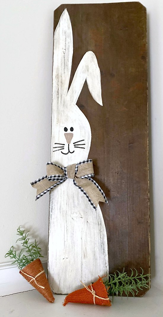 Painted bunny sign with bow and carrots