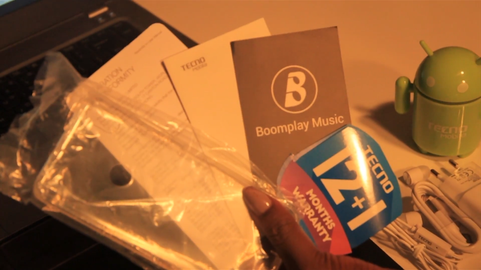 User manual, warranty card and boomplay music card