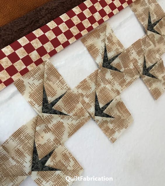 flying geese units made into chicken tracks by QuiltFabrication