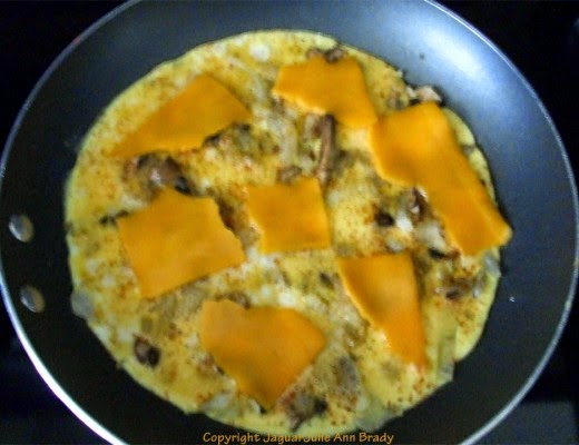 step three Cheesy Scrambled Eggs with Mushrooms and Onions